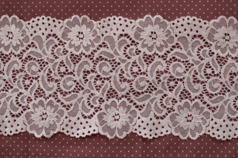 """From Borodino, only one young Kloepplerin in Dalnik, Marta Ost, was known for making bobbin-lace and practicing commercial production, especially the lacy spitzentuch and the spitzenschal. According to Frau/Mrs. Winkler-Luetze, Bessarabian-German women wore a folded cloth or """"sprang"""" net bonnet on their heads, until the midth century."""